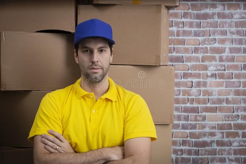 Brazilian mailman with arms crossed in a deposit stock images