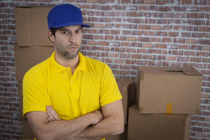 Brazilian mailman with arms crossed in a deposit stock photos