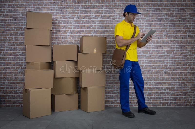 Brazilian mailman checking a lot of packages stock photos