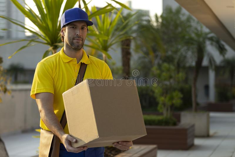 Brazilian mailman delivering a package royalty free stock photos