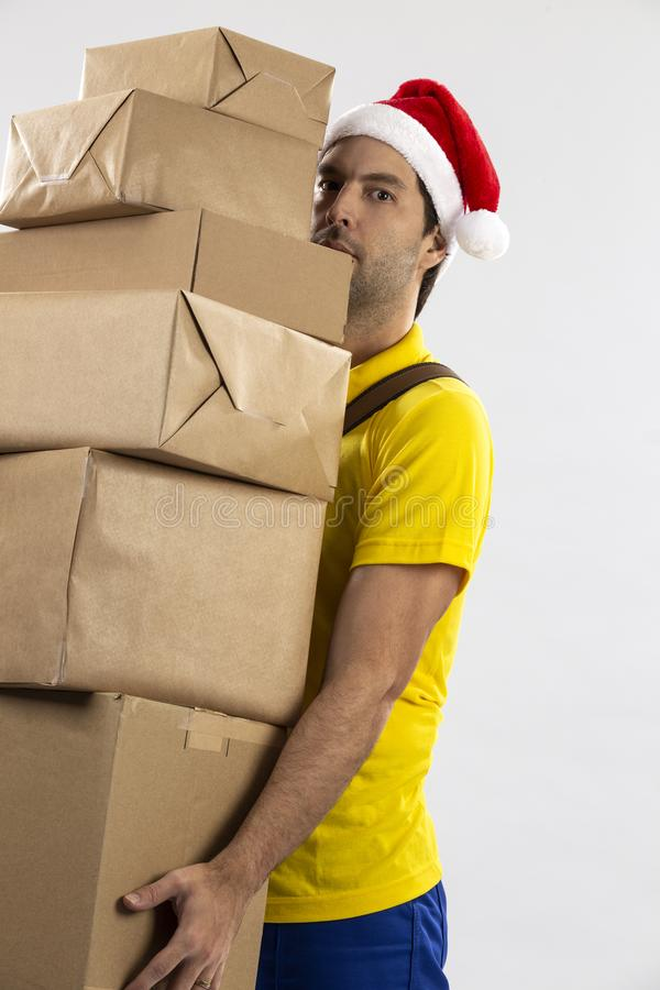 Brazilian mailman dressed as Santa Claus. Delivering a gift on a white background. copy space royalty free stock image