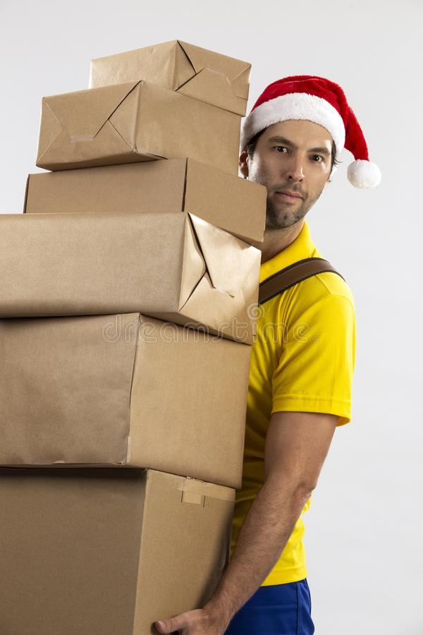 Brazilian mailman dressed as Santa Claus. Delivering a gift on a white background. copy space royalty free stock photos