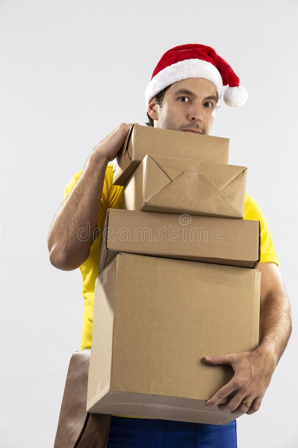 Brazilian mailman dressed as Santa Claus. Delivering a gift on a white background. copy space royalty free stock images