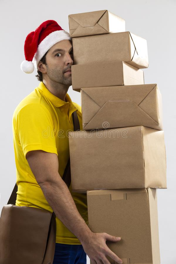 Brazilian mailman dressed as Santa Claus. Delivering a gift on a white background. copy space stock images
