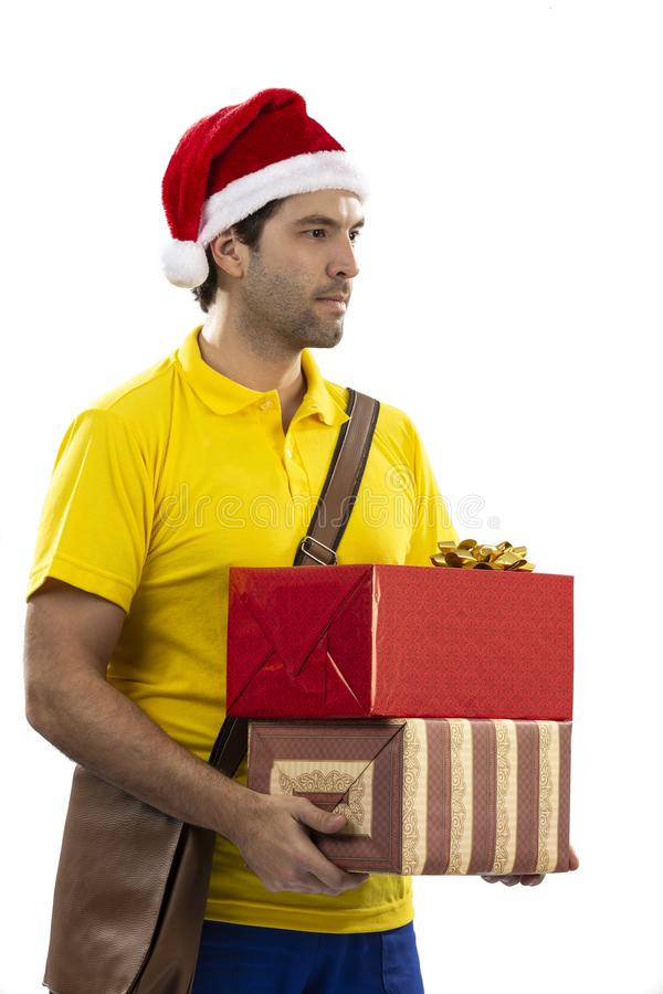 Brazilian mailman dressed as Santa Claus. Delivering a gift on a white background. copy space stock photos