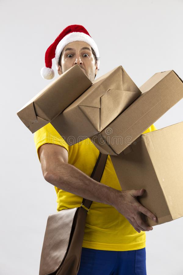 Brazilian mailman dressed as Santa Claus. Delivering a gift on a white background. copy space stock photo