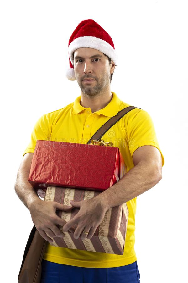 Brazilian mailman dressed as Santa Claus. Delivering a gift on a white background. copy space stock photography
