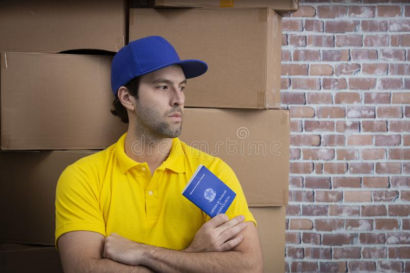 Brazilian mailman holding work book royalty free stock photography