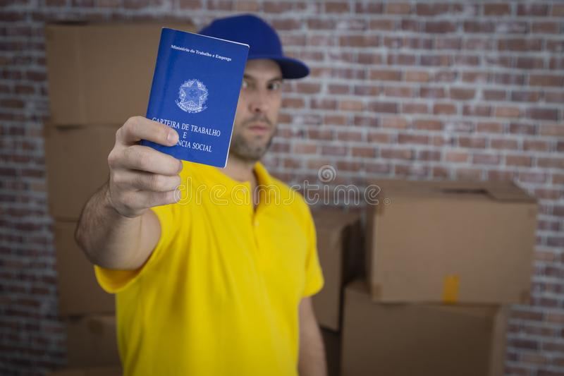 Brazilian mailman holding work book, royalty free stock photo