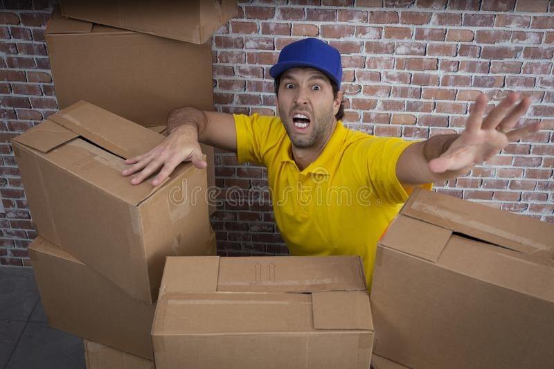Brazilian mailman lost in a lot of boxes royalty free stock images