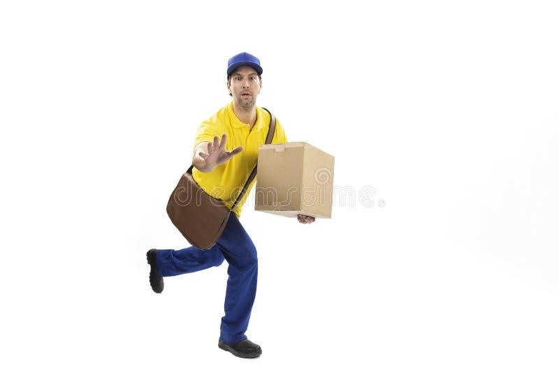 Brazilian mailman on a white background. Brazilian mailman running with a package on a white background. copy space royalty free stock photo