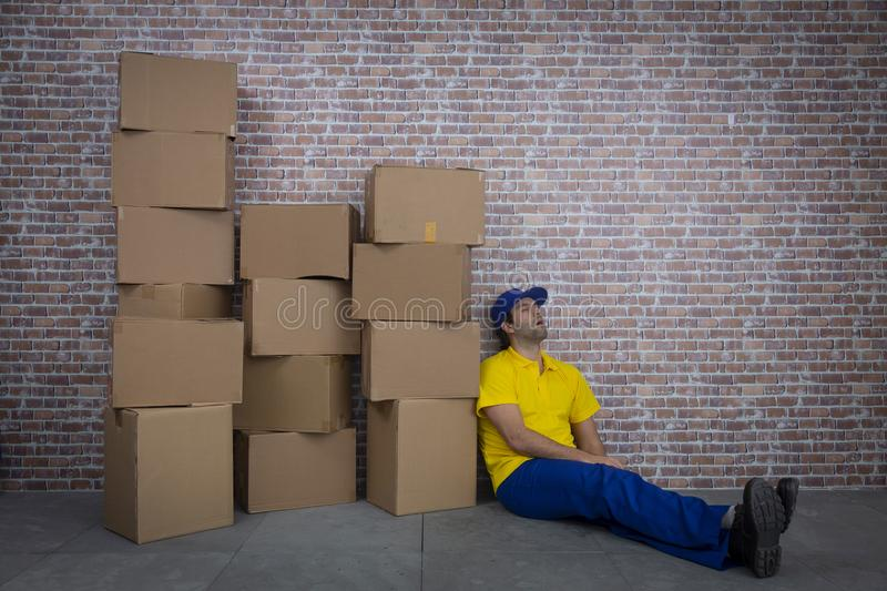 Brazilian mailman sleeping in a deposit stock photos