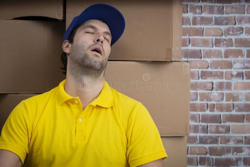 Brazilian mailman sleeping in a deposit royalty free stock photos