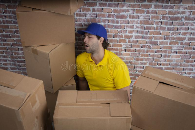 Brazilian mailman sleeping with a a lot of boxes royalty free stock images