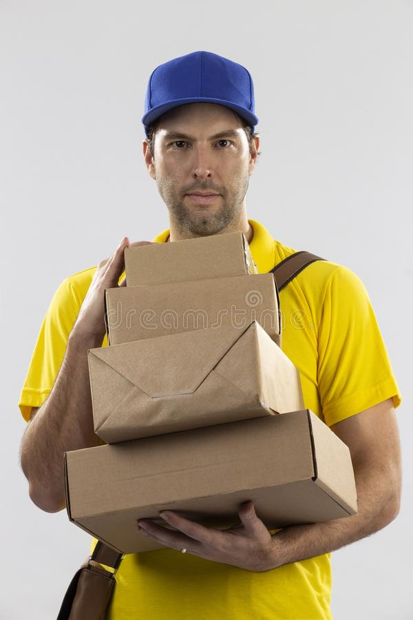 Brazilian mailman on a white background. Delivering a package. copy space stock photos