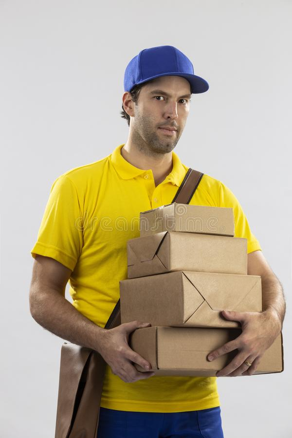 Brazilian mailman on a white background. Delivering a package. copy space stock image