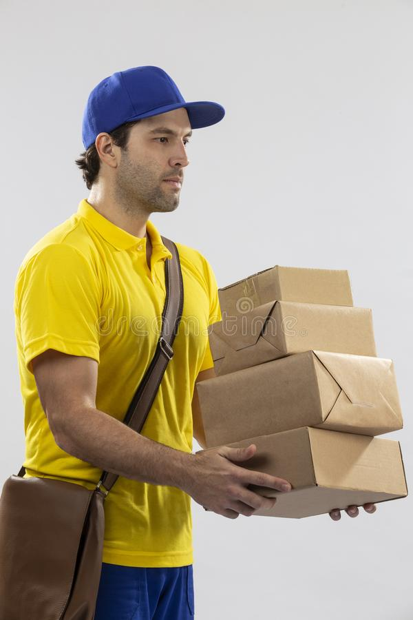 Brazilian mailman on a white background. Delivering a package. copy space stock photography