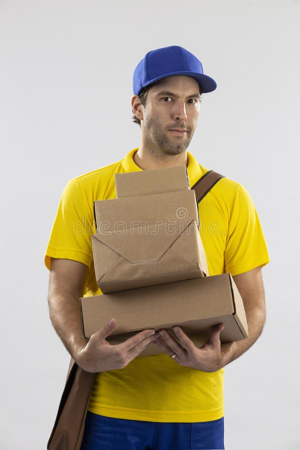 Brazilian mailman on a white background. Delivering a package. copy space stock photo