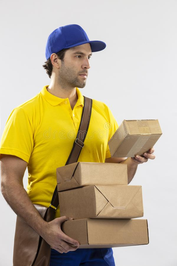 Brazilian mailman on a white background. Delivering a package. copy space royalty free stock photo