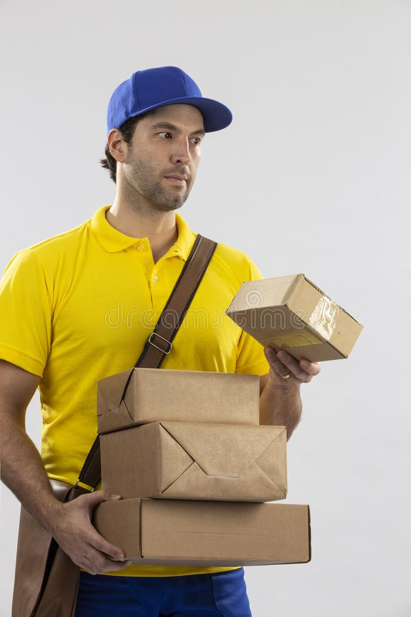 Brazilian mailman on a white background. Delivering a package. copy space royalty free stock photos