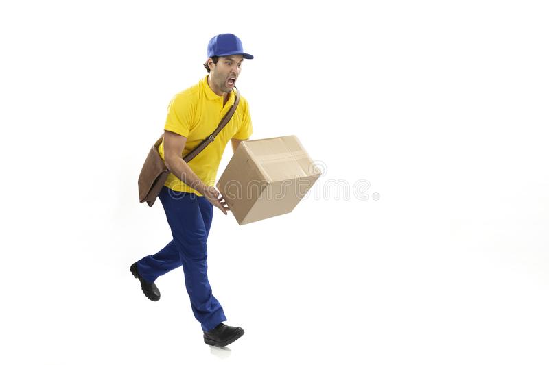 Brazilian mailman on a white background. Brazilian mailman dropping a package on a white background. copy space stock photography
