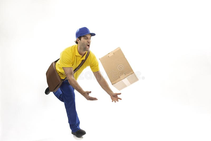 Brazilian mailman on a white background. Brazilian mailman dropping a package on a white background. copy space royalty free stock image