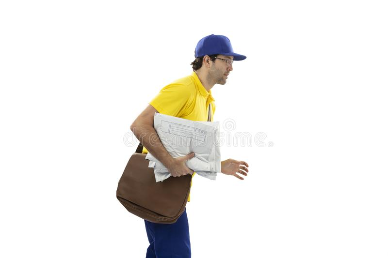 Brazilian mailman on a white background. Brazilian mailman running with a package on a white background. copy space stock photography