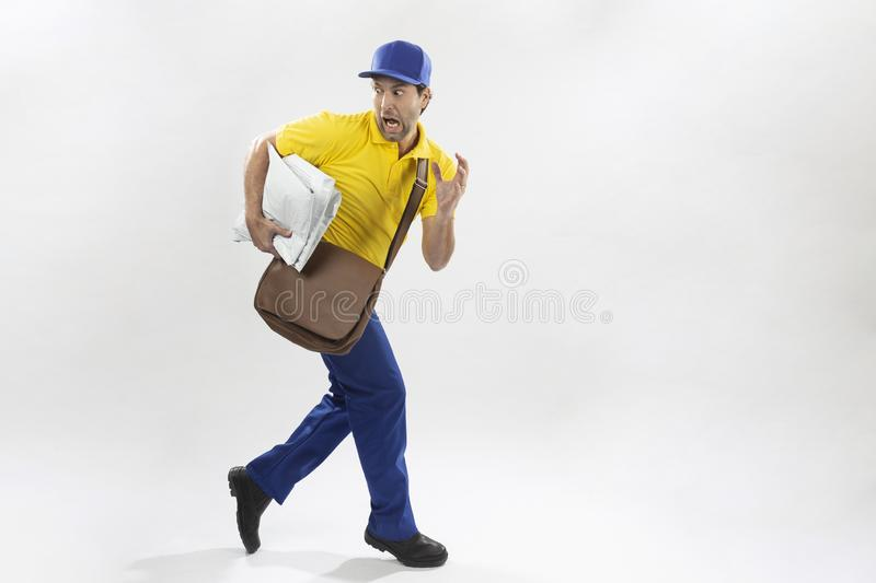 Brazilian mailman on a white background. Brazilian mailman running with a package on a white background. copy space royalty free stock image