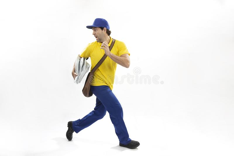 Brazilian mailman on a white background. Brazilian mailman running with a package on a white background. copy space royalty free stock photography