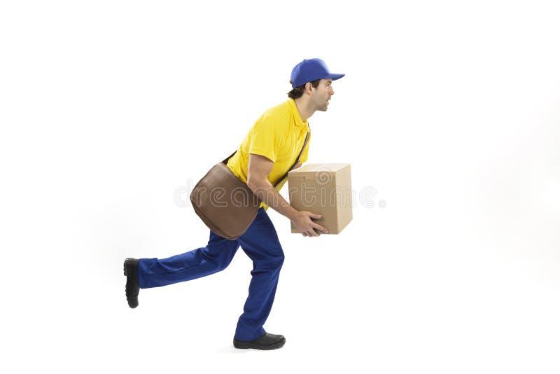 Brazilian mailman on a white background. Brazilian mailman running with a package on a white background. copy space stock photo