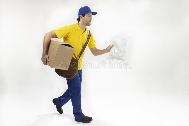Brazilian mailman on a white background. Brazilian mailman running with a package on a white background. copy space stock image