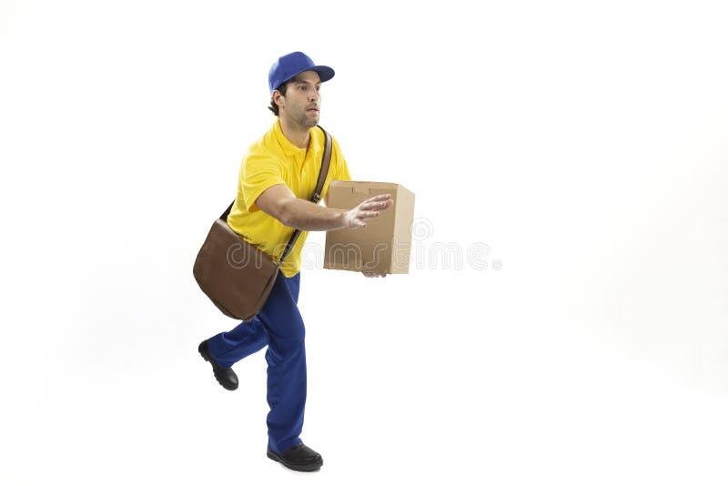 Brazilian mailman on a white background. Brazilian mailman running with a package on a white background. copy space royalty free stock photos