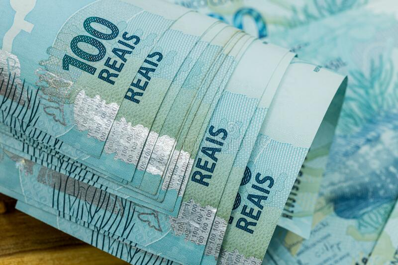 Brazilian money, Banknotes worth a hundred reais rolled up royalty free stock image