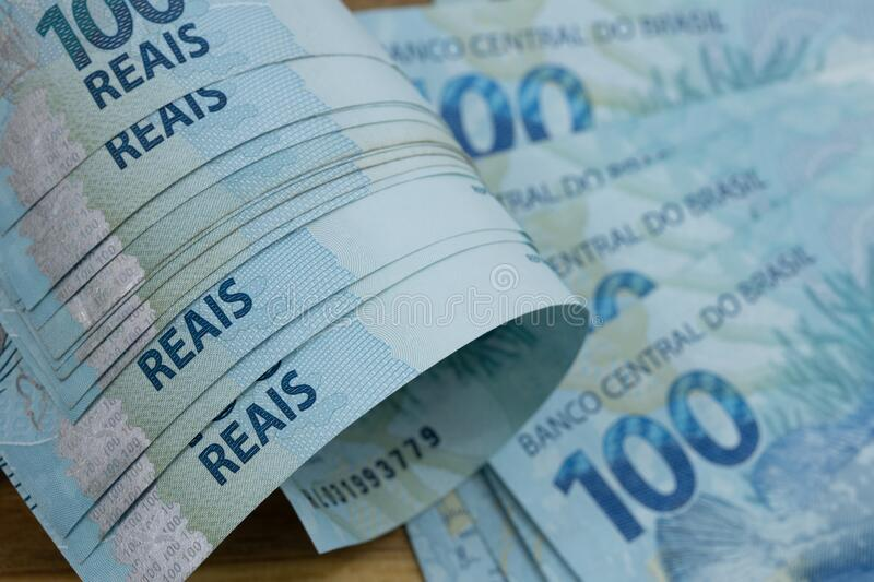 Brazilian money, Banknotes worth a hundred reais rolled up stock photography