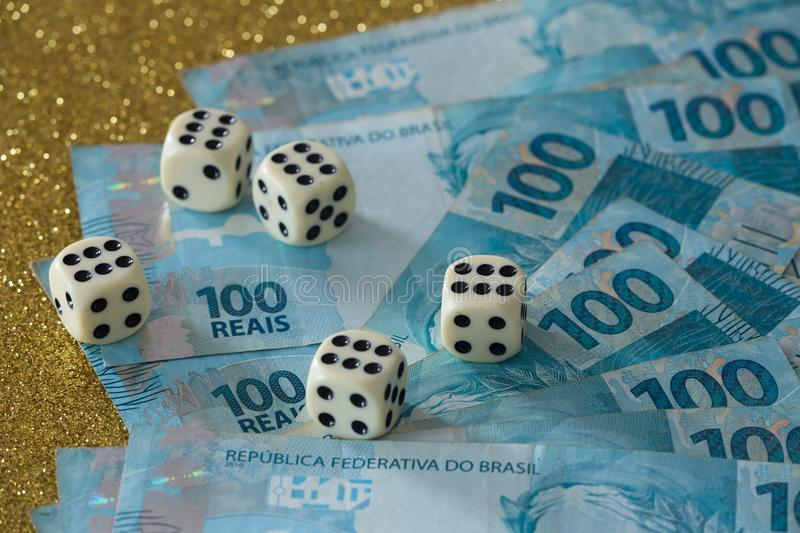 Brazilian money, reais and dice for the game / business concept royalty free stock photos