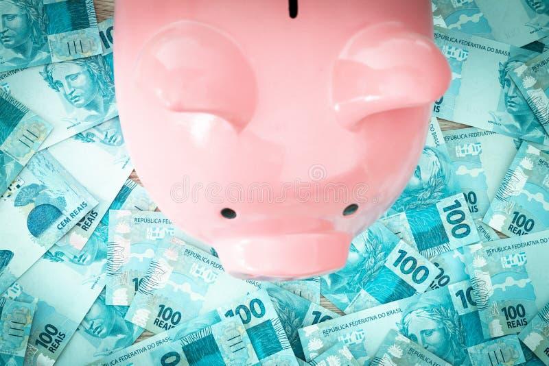 Brazilian money, reais, and piggy bank. Saving and depositing money stock photos