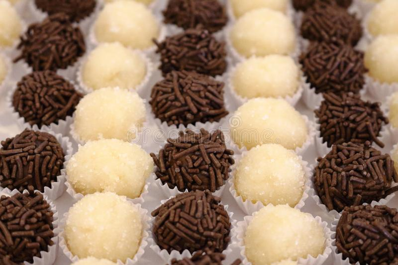 Brazilian party candy as know as brigadeiro. Made with sweet condensed milk and cocoa powder stock image