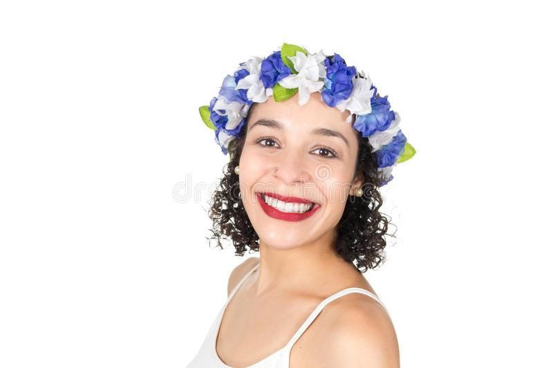 Half profile of beautiful Brazilian happy. Black woman wears a w. Brazilian is smiling and happy. Black woman is wearing a wreath in her hair. She is dressed for stock images