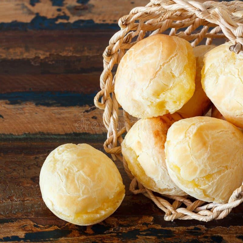 Brazilian snack cheese bread (pao de queijo) in wicker basket stock photos