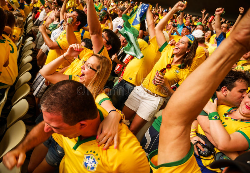 Ecstatic Brazilian Soccer Fans. FORTALEZA, BRAZIL - 4 JULY 2014: A moment of excitement and delight as Brazilian football fans celebrate their team scoring a royalty free stock image