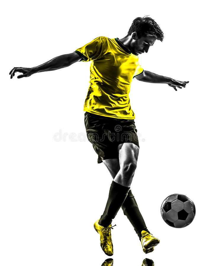 Brazilian soccer football player young man dribbling silhouette royalty free stock image