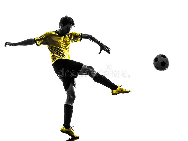 Brazilian soccer football player young man kicking silhouette stock photos