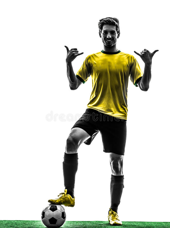 Brazilian soccer football player young man saluting silhouette. One brazilian soccer football player young man standing saluting in silhouette studio on white royalty free stock photos