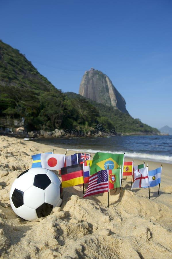 Brazilian Soccer International Flags Beach Football Rio de Janeiro. Brazilian soccer ball with international flags on Praia Vermelha Red Beach at Sugarloaf royalty free stock photos