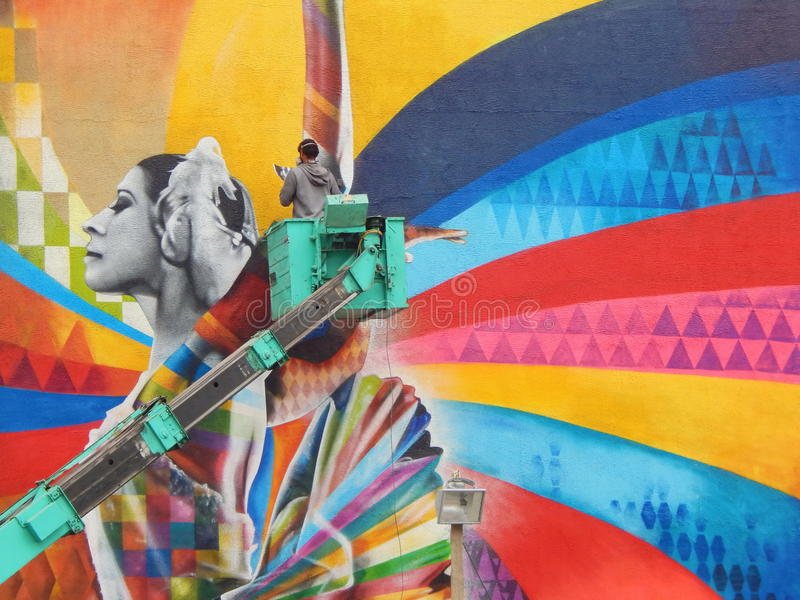 Brazilian street artist Eduardo Kobra is painting a portrait of ballerina Maya Plisetskaya in the centre of Moscow. royalty free stock photography
