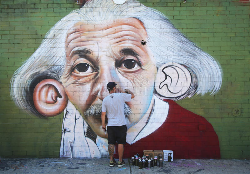 Brazilian street artist Sipros painting mural at East Williamsburg in Brooklyn. royalty free stock photo
