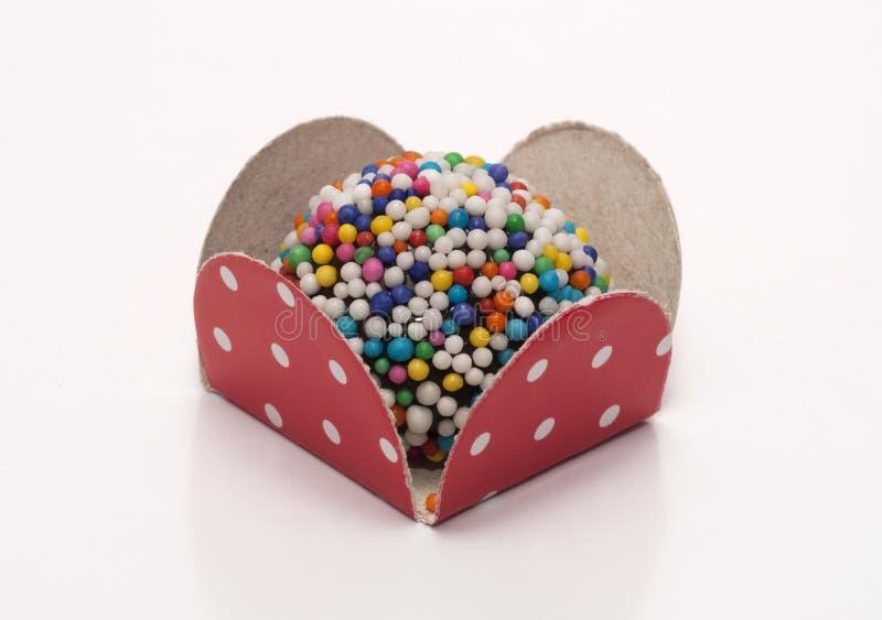 Brazilian Sweet - Brigadeiro. / Brigadeiro with colorful beads / Brigadeiro is a brazilian sweet made with condensed milk and chocolate stock image