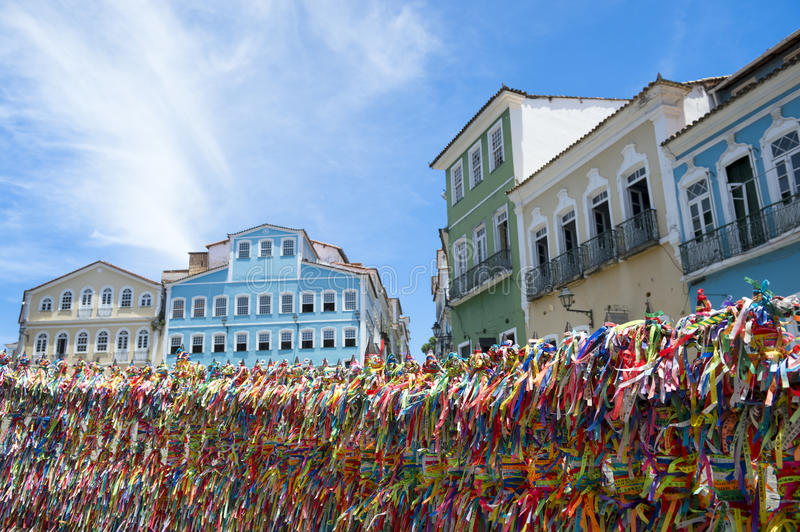 Brazilian Wish Ribbons Pelourinho Salvador Bahia Brazil. Decorative Brazilian wish ribbons tied to a church gate frame a view of bright colonial architecture of royalty free stock images