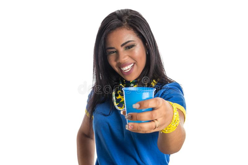 Brazilian woman fan celebrating on football match on white background. royalty free stock images