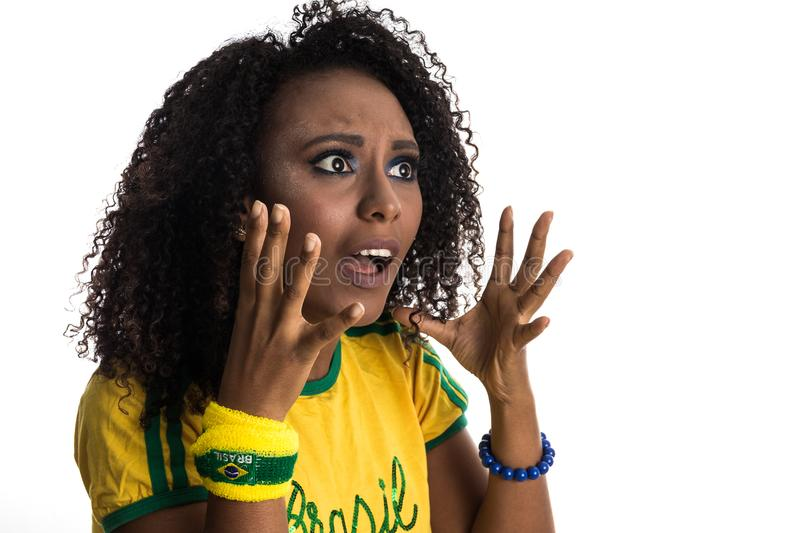 Brazilian woman fan celebrating on football match on white background. Brazil colors. Surprised. Brazil supporter. Brazilian woman fan celebrating on soccer / royalty free stock photography